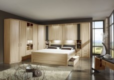 A bedroom with different storage solutions